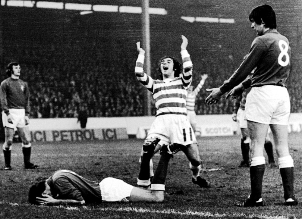 Celtic's Lou Macari (c) celebrates his team's only goal in a 2-1 defeat